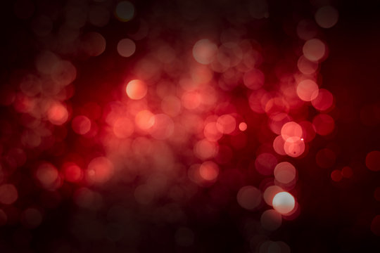 Abstract red background with soft blur bokeh light effect.