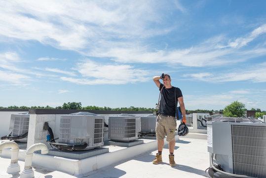 HVAC tech on roof