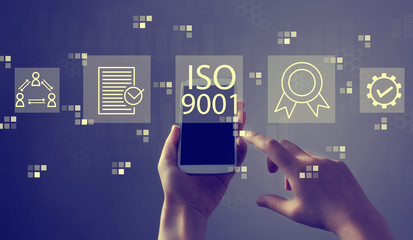 ISO 9001 with person holding a white smartphone