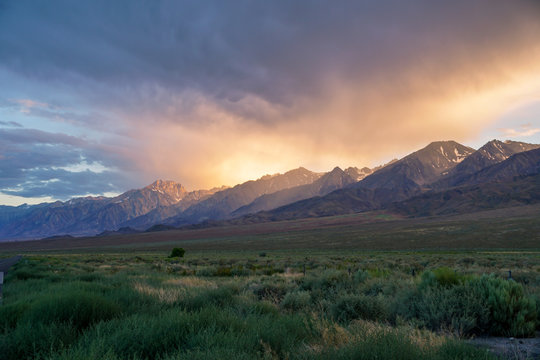 Mountain range colorful sunset with clouds before storm , Eastern Sierra Mountains, Mono County, California, USA
