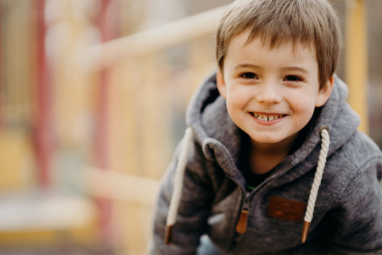 Portrait of a happy little boy at the playground