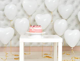 Birthday cake and hear shaped balloons background