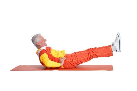 Portrait of senior man exercising isolated on white background