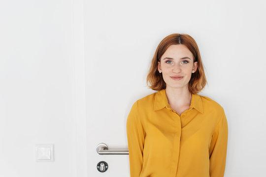 Attractive young redhead woman smiling at camera