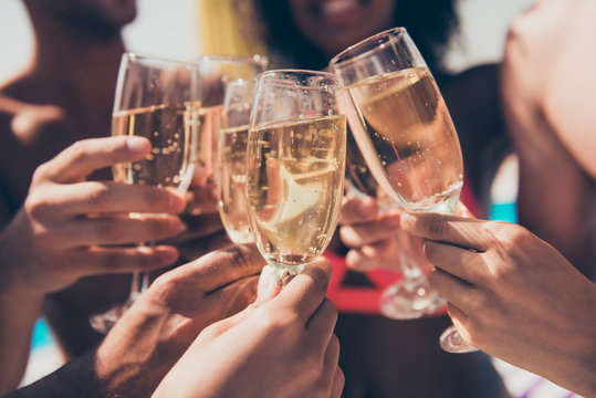Cropped photo of many people hanging out clink glasses with champagne