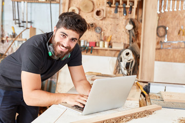 Fototapeta Young man in online customer service obraz