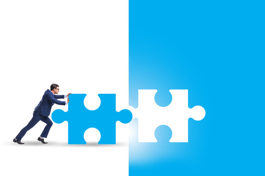 Concept of businessman with missing jigsaw puzzle piece