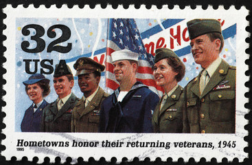 American soldiers coming back home after World War II on postage stamp