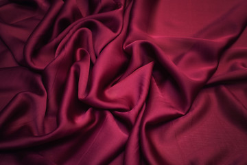 The texture of silk fabric color Marsala. Background, pattern, chiffon.