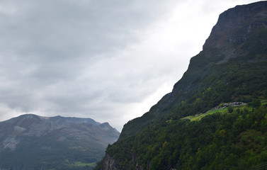 Mountain landscape near Norwegian fjord, Geiranger. Mountains and clouds. Beautiful Norwegian nature, Geiranger