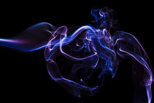 Abstrakcyjne tło z kolorowym dymem. Kolorowe fale, linie i kształty z dymu.