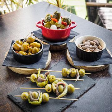 spanish tapas, banderillas, gildas, olives and almonds