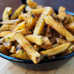 french fries potatoes on a black pan