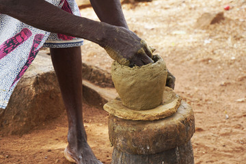 Women doing traditional pottery near Kara in Togo
