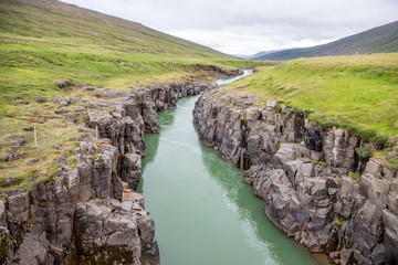 a river in the lava landscape of Iceland.