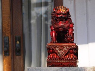 A foo dog or foo lion often found in pairs on the front porch of Asian American homes