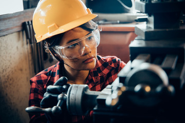 Asian beuatiful woman working with machine in the factory engineer and working woman concept or woman day Wall mural