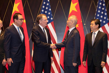 U.S. Trade Representative Robert Lighthizer shakes hands with Chinese Vice Premier Liu He as U.S. Treasury Secretary Steven Mnuchin and China's Commerce Minister Zhong Shan look on during a family photo at the Xijiao Conference Center in Shanghai