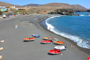 Black Sand Beach with Colorful Boats in Fuerteventura, Canary Islands