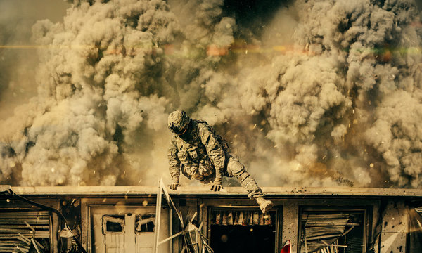 The military soldier escaping blast on the roof of destroyed house