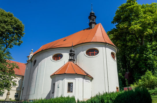 St. Libor Church with blue sky and green trees in the background