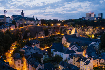 The Skyline of Luxembourg City at night.  The Old Town of Luxembourg is a UNESCO World Heritage Site. Neumünster Abbey, the banks of the Alzette River in the lower city, known as the Grund Quarter.