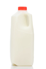 A one quart plastic bottle of milk, with red cap and no label