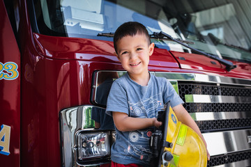 Little Boy On Red Fire Engine Wall mural