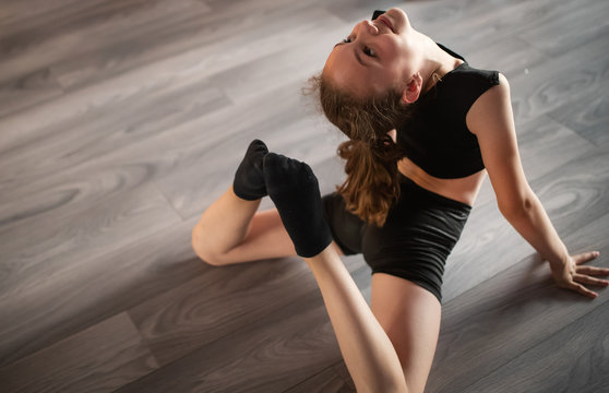 Sport, training, stretching, dancing active lifestyle concept. Young girl practicing dance