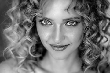 Foto auf AluDibond Friseur Close up portrait of blonde charming young woman with curly hair and natural makeup. Sunny morning, spa and care