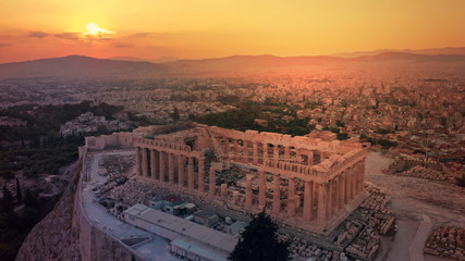 Aerial drone photo of iconic Acropolis hill and the unique masterpiece of Ancient world the Parthenon at sunset with beautiful golden colours, Athens historic centre, Attica, Greece Wall mural