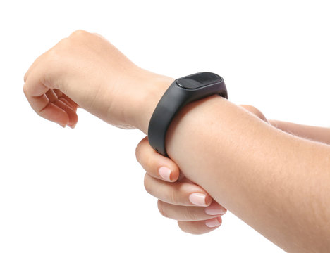 Woman with fitness band checking her pulse on white background