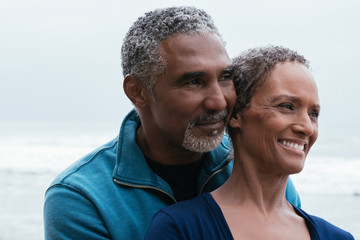 Mature couple enjoying beach