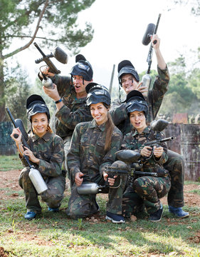 Portrait of paintball players wearing uniform and holding guns ready for playing