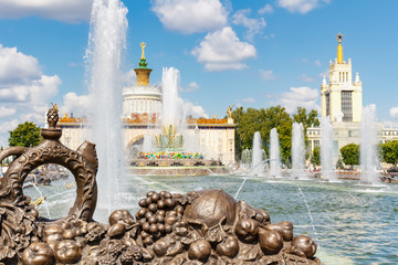 Stone Flower Fountain in VDNH park in Moscow against blue sky at sunny summer day. Exhibition of...
