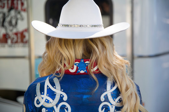 Rear view of blond woman wearing white hat