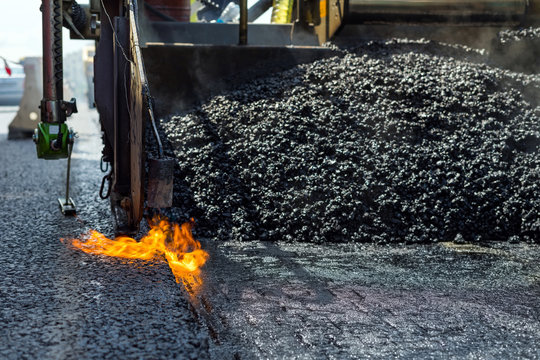 Construction and repair road. Technology and principles of joining road asphalt pavements using asphalt paver machine.