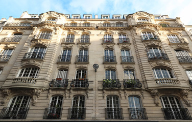 Traditional French house with typical balconies and windows. Paris.