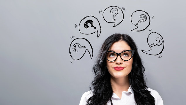Question marks with speech bubbles with young businesswoman in a thoughtful face