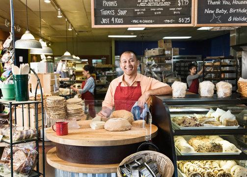 Portrait of smiling baker standing in bakery