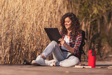 Female artist drawing outdoors