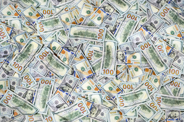 Pile of one hundred US dollar bills as background