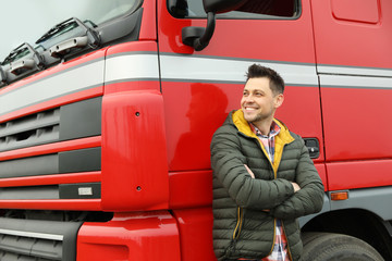 Portrait of happy driver at modern truck outdoors Fototapete