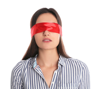 Young woman wearing red blindfold on white background