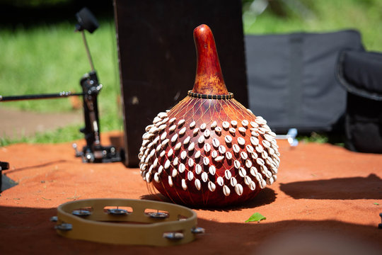 SHekere authentic african instrument outdoor shaker at day
