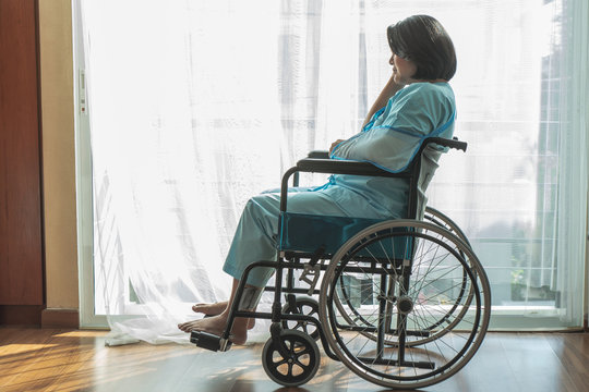 lonely person on a wheelchair after accident injured.