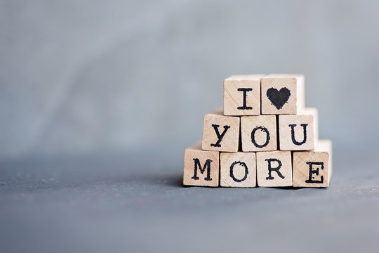 I heart you more written in stamp letters