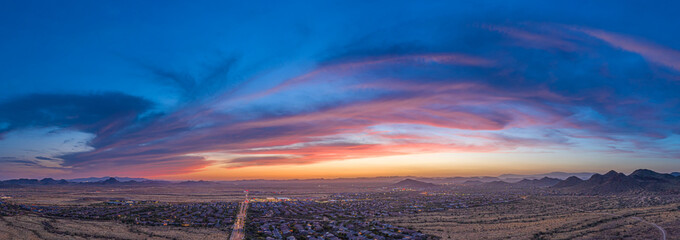 Panoramic aerial view of a desert community in Arizona during the golden hour at sunset. Wall mural