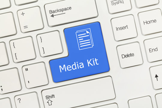 White conceptual keyboard - Media Kit (blue key)
