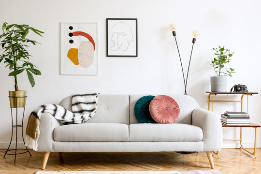 Minimalist interior design of living room with sofa and framed posters